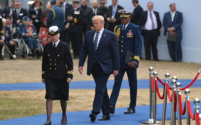US President Donald Trump (C) returns to his seat after speaking during an event to commemorate the 75th anniversary of the D-Day landings, in Portsmouth, southern England, on 5 June 2019. Picture: AFP