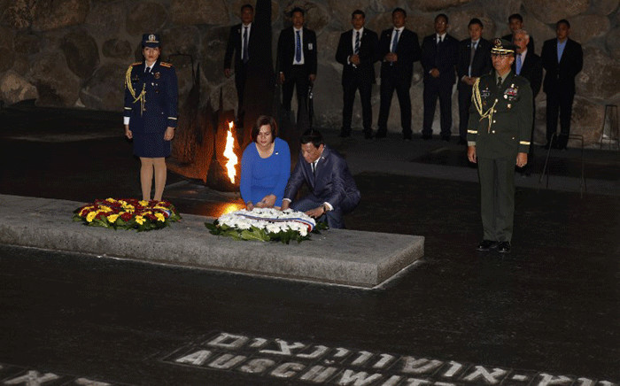 The President of the Philippines Rodrigo Duterte (R) and his daughter lay a wreath at the Hall of Remembrance on September 3, 2018 during his visit to the Yad Vashem Holocaust Memorial museum in Jerusalem commemorating the six million Jews killed by the German Nazis and their collaborators during World War II. Picture: AFP.