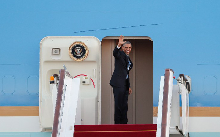 US President Barack Obama boards Air Force One shortly before departing from Capital International Airport in Beijing on 12 November, 2014. Picture: AFP.