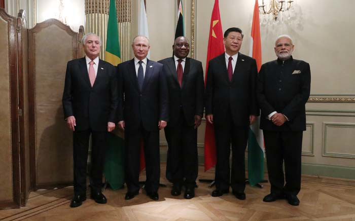 (L to R) Brazil's President Michel Temer, Russia's President Vladimir Putin, South Africa's President Cyril Ramaphosa, China's President Xi Jinping and India's Prime Minister Narendra Modipose for the media during a BRICS Leaders' meeting in the sidelines of the G20 Leaders' Summit in Buenos Aires, on 30 November 2018. Picture: AFP