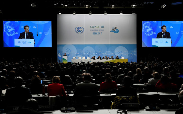 French President Emmanuel Macron is seen on giant screens as he speaks during the UN conference on climate change (COP23) on November 15, 2017 in Bonn, western Germany. Picture: AFP