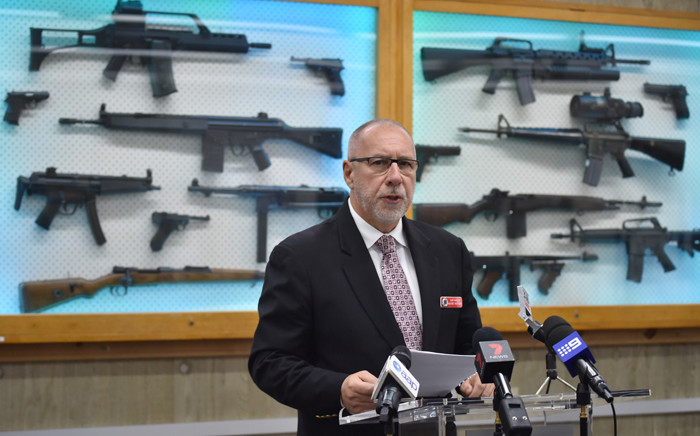 FILE: Detective Chief Inspector Wayne Hoffman of the New South Wales Police speaks to the media at a press conference at their headquarters in Sydney on 8 August, 2017, as guns previously seized from criminals are seen behind him. Picture: AFP.