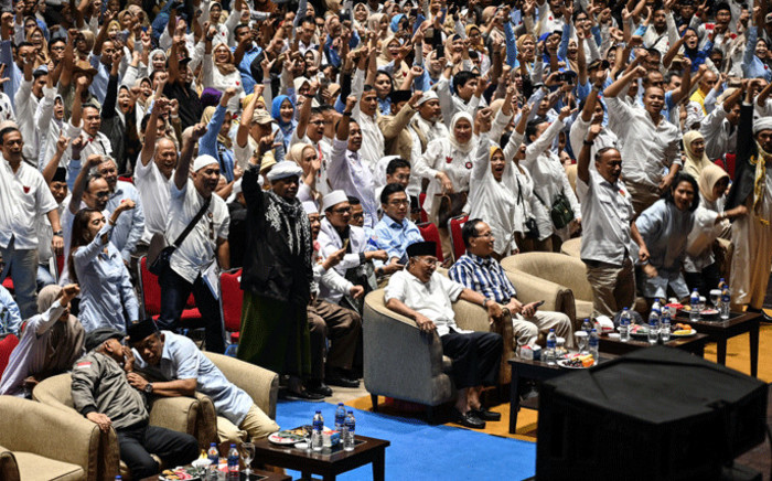 President candidate ex-general Prabowo Subianto's supporters shout slogans and gesture during a presidential election winning celebration in Jakarta, on 24 April, 2019, that Prabowo claimed. Picture: AFP.