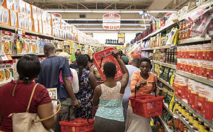 Customers trying to manouevre in the shopping aisle during Black Friday 2019 in Shoprite in Diepsloot. Picture: Abigail Javier/EWN