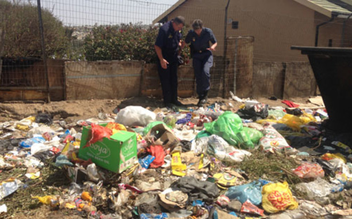 The body of a child was found behind a dumpster in Diepsloot on 9 September 2013. Picture: Sebabatso Mosamo/EWN