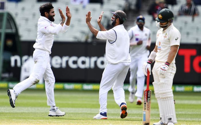 India's Ravi Jadeja (L) and Ajinkya Rahane (C) celebrate dismissing Australia's Matthew Wade (R) on the third day of the second cricket Test match between Australia and India at the MCG in Melbourne on 28 December 2020. Picture: AFP