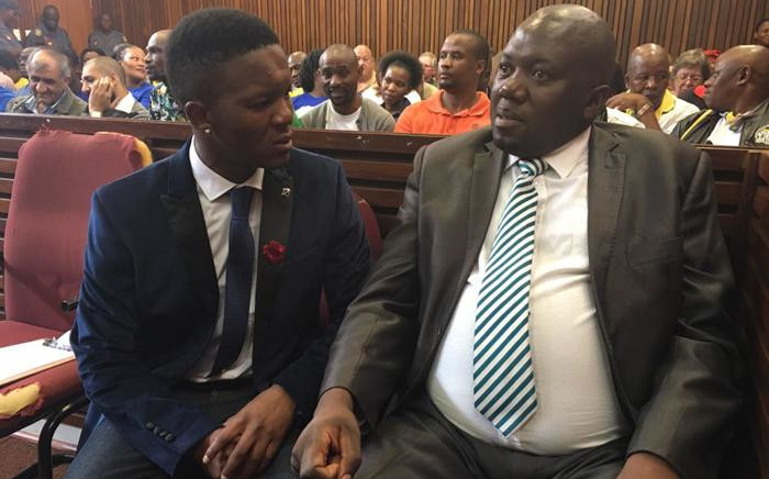 FILE: Rethabile Mlotshwa with his lawyer ahead of proceedings inside the Middelburg Magistrates Court during the sentencing of Theo Jackson and Willem Oosthuizen on 23 October 2017. Picture: Ziyanda Yono/EWN.
