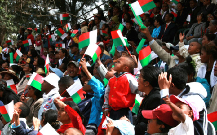 FILE: Madagascans wave the national flag during celebrations of the 50 years of independence in Antananarivo on 26 June, 2010. Picture: AFP.