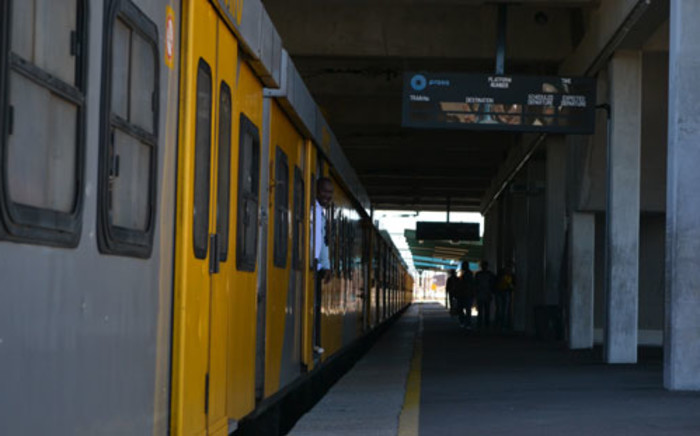 Two suspected robbers were stoned, beaten and tied to a train track to die by angry residents near Philippi.