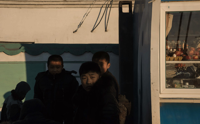 FILE: In a photo taken on 19 November 2017, children stand on a roadside on the outskirts of the industrial city of Chongjin on North Korea's northeast coast. Picture: AFP.