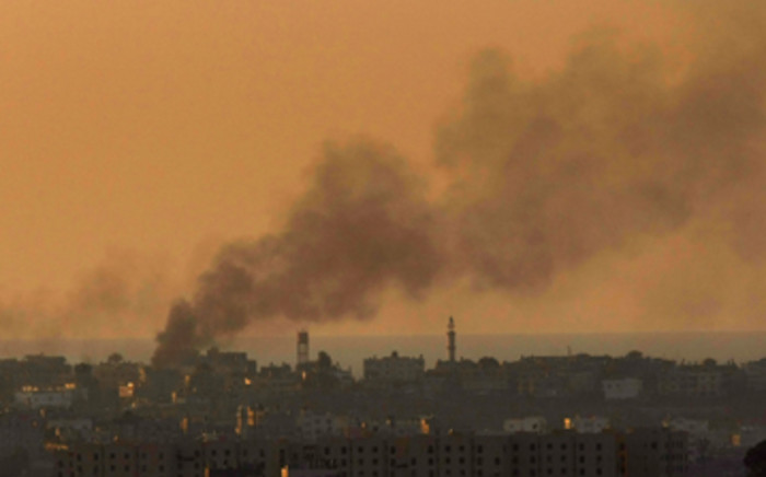 Smoke rises over Gaza City after days of fighting between Israeli troops and Hamas militants as seen from Israel's border with the Palestinian territory. Picture: David Silverman/Getty Images
