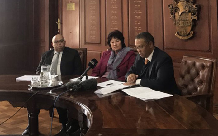Western Cape Community Safety MEC Albert Fritz (left), an AfriForum representative (centre) and Agriculture MEC Ivan Meyer (right)  at a media briefing on farm attacks in the province on 3 June 2019. Picture: Kaylynn Palm/EWN