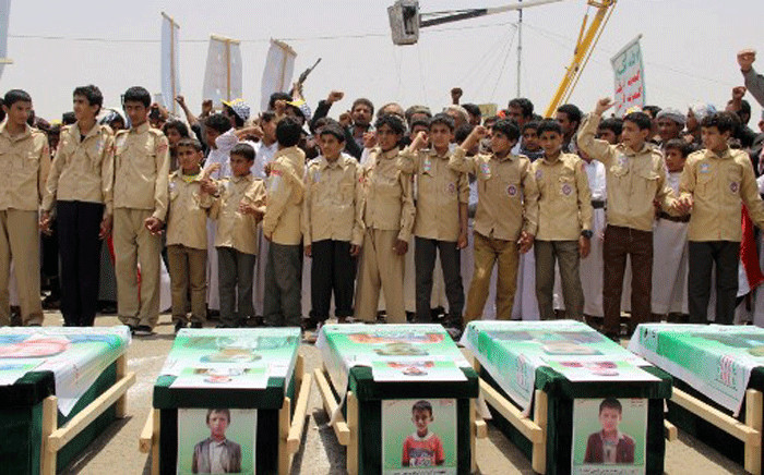 Yemeni children vent anger against Riyadh and Washington on August 13, 2018 as they take part in a mass funeral in the northern Yemeni city of Saada, a stronghold of the Iran-backed Huthi rebels, for children killed in an air strike by the Saudi-led coalition last week. Picture: AFP.