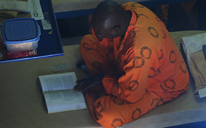 An offender studying inside a cell at Leeuwkop Prison. Picture: Taurai Maduna/Eyewitness News