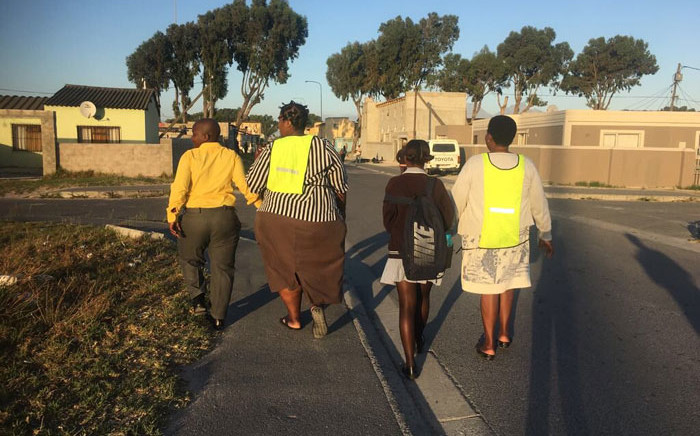 Parents escort pupils to school in Nyanga on 17 January 2018. Picture: @equal_education/Twitter
