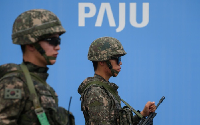 FILE: South Korea soldiers stand on the Unification Bridge that leads to the demilitarised zone (DMZ) between North and South Korea in Paju on 24 August 2015. Picture: AFP.