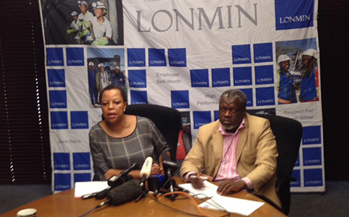 Lonmin corporate affairs vice president Lerato Molebatsi and head of stakeholder relations and public affairs Happy Nkhoma at a press conference on 15 May 2014. Picture: Vumani Mkhize/EWN.