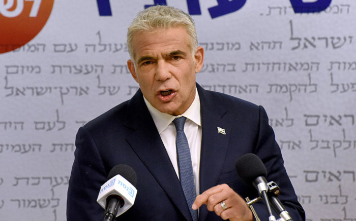 Israel's centrist opposition leader Yair Lapid delivers a statement to the press at the Knesset (Israeli parliament) in Jerusalem on 31 May 2021. Picture: Debbie Hill/AFP