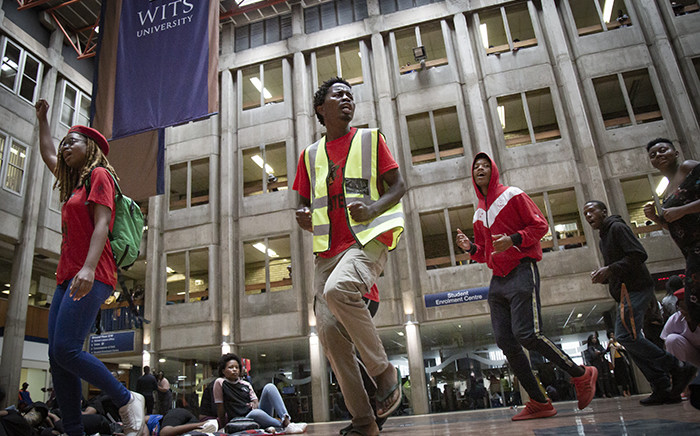 A group of Wits University students staging a small demonstration at Solomon Mahlangu House on 5 February 2019. Picture: Sethembiso Zulu/EWN