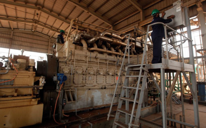 Sudanese repair crew work at the Heglig oil facility, after Sudan started pumping oil again from the war-damaged oil field on May 2, 2012. Picture: AFP.