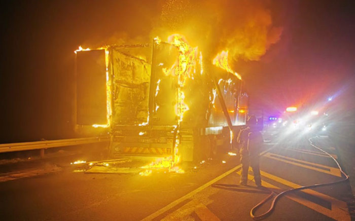 A firefighter tries to extinguish a burning truck in Worcester on 3 September 2019. Picture: Supplied