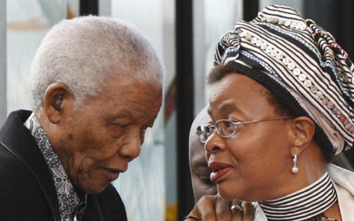 Nelson Mandela is aided by his wife, Graca Machel in 2009. Picture: AFP