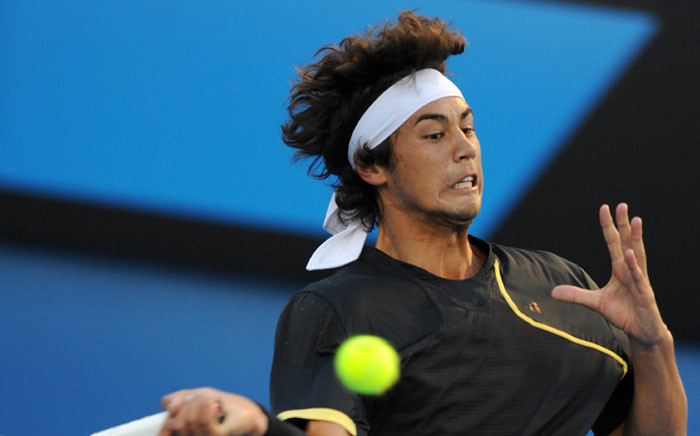 Australian tennis player Nick Lindahl plays a forehand return during his men's singles match Finnish opponent Jarkko Niemenen on the first day of play at the Australian Open tennis tournament in Melbourne on 18 January 2010. Picture: AFP /Greg Wood.