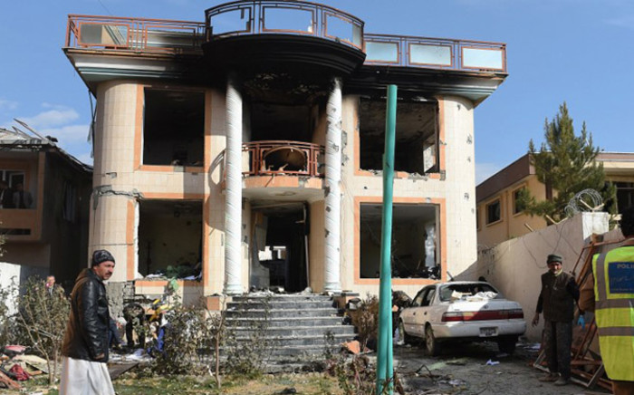 Afghan officials are pictured on a foreign compound following an attack by Taliban militants in Kabul on 30 November, 2014. Picture: AFP.