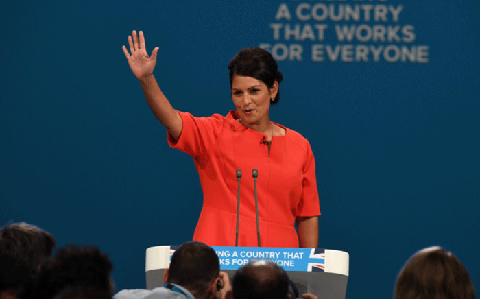 Britain's International Development Secretary Priti Patel gestures after delivering her speech on the third day of the Conservative Party annual conference at the Manchester Central Convention Centre in Manchester on 3 October, 2017. Picture: AFP.