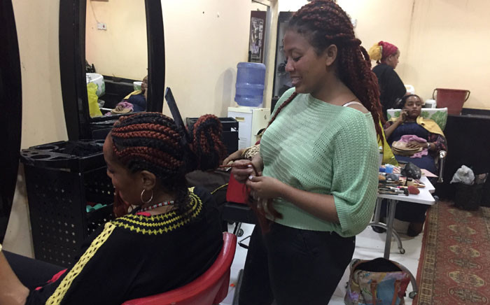 Women have their hair styled at a hairdresser's salon in the Sudanese capital Khartoum on 29 August 2019. Picture: AFP
