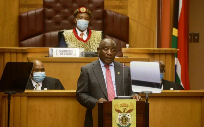 FILE: Cyril Ramaphosa at the annual opening of the National House of Traditional Leaders on 4 March 2021, with chairperson Inkosi Mahlangu above him. Picture: GCIS