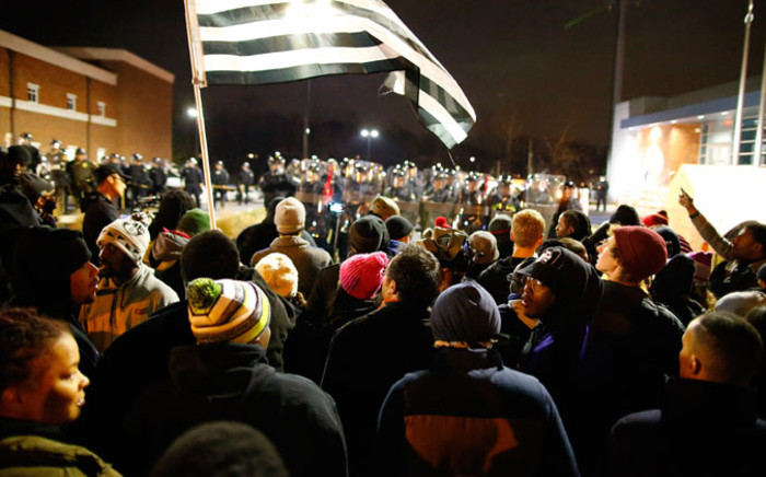Protesters face a line of riot police in Ferguson, Missouri, on 24 November 2014. According to St Louis County Prosecuting Attorney, the Grand jury decided that Ferguson police Officer Darren Wilson will not be charged in the shooting death of unarmed teenager Michael Brown. Picture: EPA.