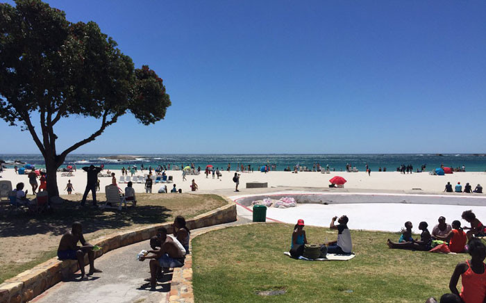 Beachgoers pictured at Camps Bay in Cape Town. Picture: Monique Mortlock/EWN.