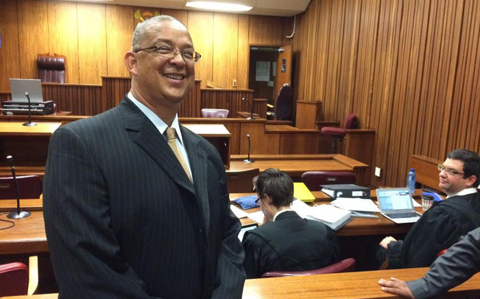 FILE. IPID head Robert McBride approaches the High Court in Pretoria, on 13 March 2015, to interdict Police Minister Nathi Nhleko from suspending him. Picture: Barry Bateman/EWN.