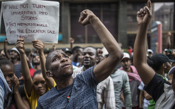 FILE: Students shout slogans outside the African National Congress ruling party (ANC) headquarters, on October 22 2015, in Johannesburg during a demonstration against university fee hikes. Picture: AFP