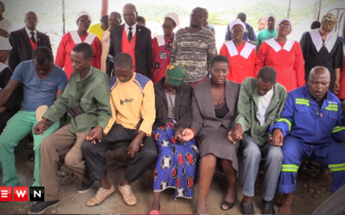 FILE: Members from all three families of the trapped mineworkers at Lily Mine sitting and praying together. Picture: Eyewitness News.