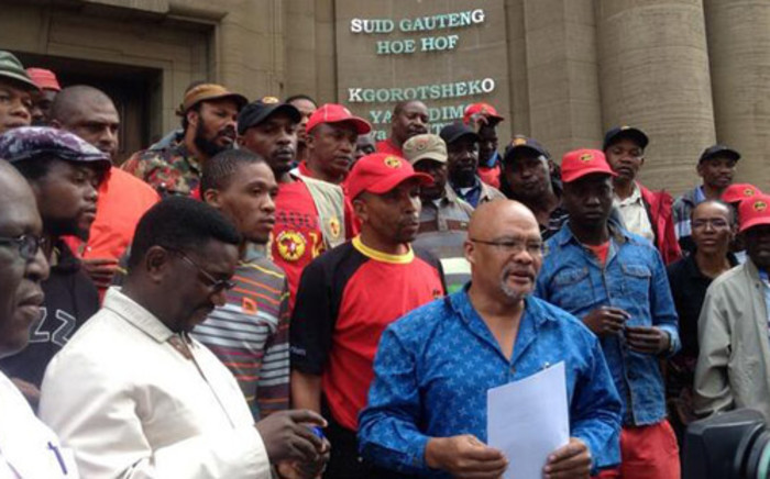 Numsa and other affiliates in support of Vavi address media outside the South Gauteng High Court ON 4 April 2014. Picture: Govan Whittles/EWN
