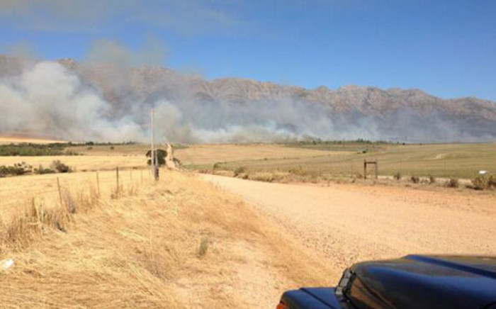 A fire on the slopes above Imizamo Yethu in Hout Bay has been extinguished. Picture: Twitter.