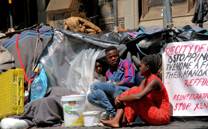 FILE: Foreign nationals in their makeshift shelters outside the Central Methodist Mission Church in Greenmarket Square in Cape Town. Picture: Kaylynn Palm/EWN