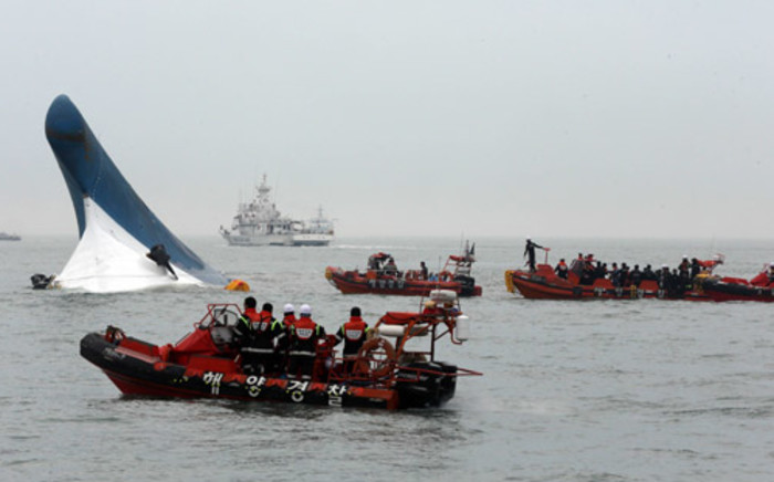South Korea Coast Guard members searching for passengers near a South Korean ferry after it capsized on its way to Jeju island from Incheon on 16 April 2014. Picture: AFP