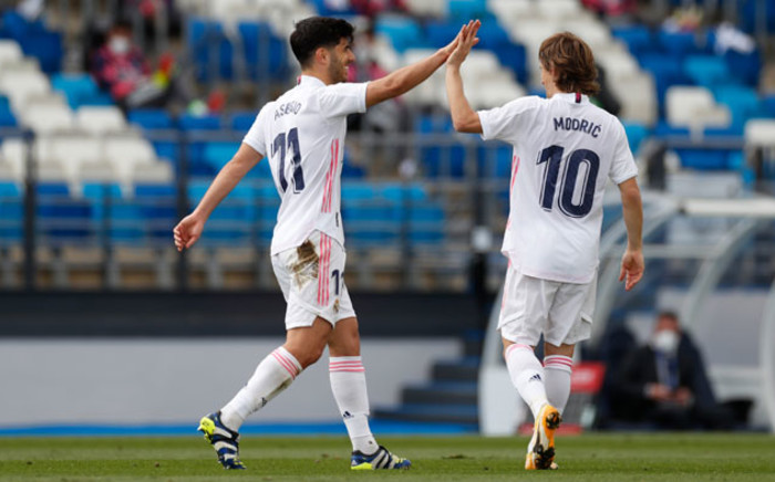 Marco Asensio and Luka Modric celebrate a goal against Eibar in their La Liga match on 3 April 2021. Picture: @realmadriden/Twitter