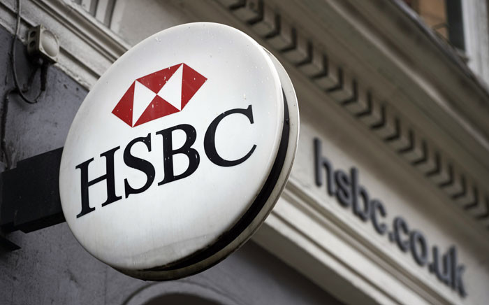 FILE: A HSBC bank logo is seen on a sign outside a branch of the bank in London on 22 October 2015. Picture: AFP.