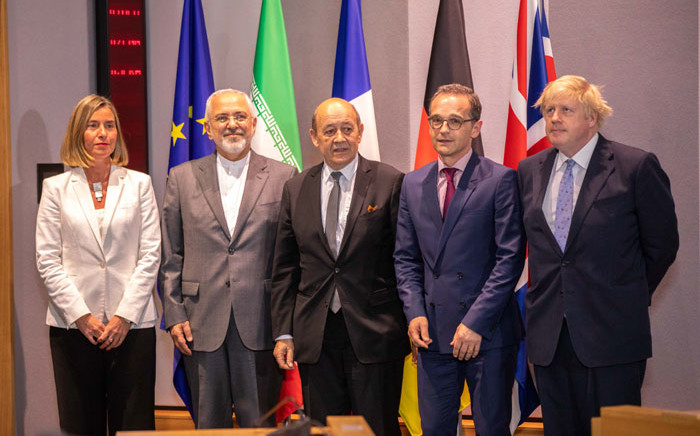 Iran's Foreign Minister Mohammad Javad Zarif (2L) poses with Britain's Foreign Secretary Boris Johnson (R), France's Foreign Minister Jean-Yves Le Drian (C), Germany Foreign Minister Heiko Maas (2R) and EU High Representative for Foreign Affairs Federica Mogherini (L) during a meeting in Brussels, on 15 May, 2018. Picture: AFP