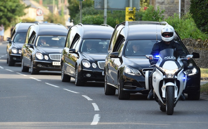 A line of hearses carrying the coffins of eight of thirty Britons killed in last week's Jihadist attacks in Tunisia leave RAF Brize Norton after being repatriated on 1 July 2015. Picture: AFP.