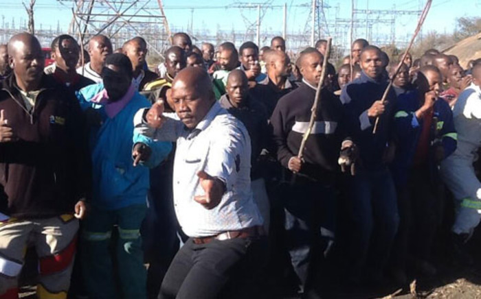 Lonmin miners at Marikana chant ahead of one year anniversary at Lonmin's Marikana mine where 34 striking platinum workers were shot dead by police on 16 August 2012. Picture: Gia Nocolaides/EWN