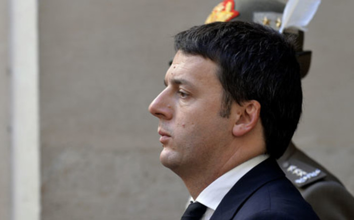 Italy's new Prime Minister Matteo Renzi stands in the courtyard of Rome's Chigi palace on 22 February 2014. Picture: AFP