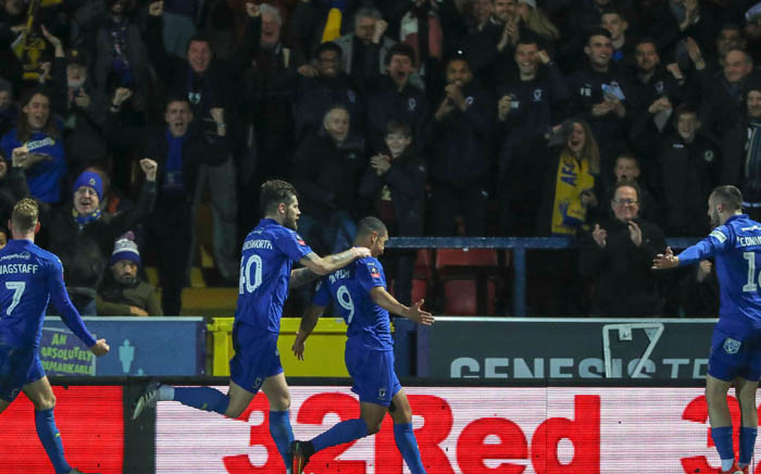 AFC Wimbledon players celebrate a goal against West Ham during their FA Cup clash. Picture: @AFCWimbledon/Twitter.
