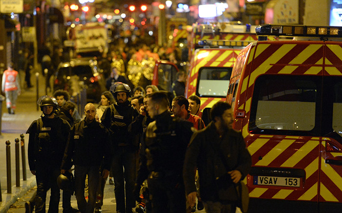 FILE: Police forces and rescuers walk through rue Oberkampf near the Bataclan concert hall in central Paris, early on November 14, 2015. Picture: AFP