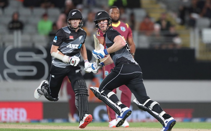 New Zealand's James Neesham (R) and Mitchell Santner (L) run between the wickets during the Twenty20 international cricket match between New Zealand and the West Indies at Eden Park in Auckland on November 27, 2020. Picture: AFP