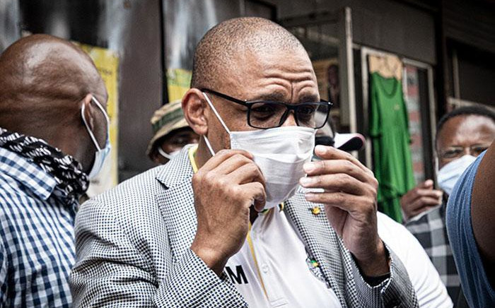 ANC spokesperson Pule Mabe accepts a memorandum of demands from protesting Free State ANC members at the party's Luthuli House headquarters in Johannesburg on 19 October 2020. Picture: Xanderleigh Dookey/EWN